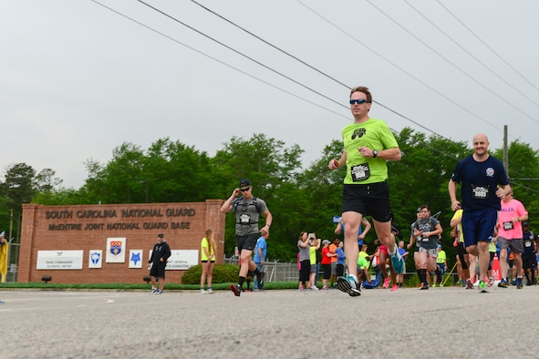 Runners participate in the inaugural YMCA-Sumter Base-2-Base Race, May 1, 2016 along Garners Ferry Road, in Eastover, S.C. The 21-mile race began at the front gate of McEntire Joint National Guard Base with the finish line at Shaw Park, near Shaw Air Force Base.  (U.S. Air National Guard photo by Airman 1st Class Megan Floyd)