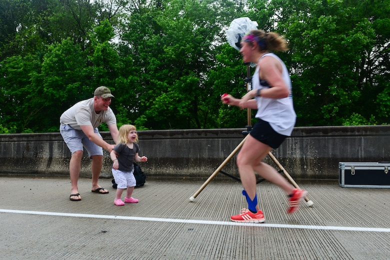 Family members cheer on runners in the inaugural YMCA-Sumter Base-2-Base Race, May 1, 2016 along Garners Ferry Road, in Eastover, S.C. The 21-mile race began at the front gate of McEntire Joint National Guard Base with the finish line at Shaw Park, near Shaw Air Force Base.  (U.S. Air National Guard photo by Airman 1st Class Megan Floyd)