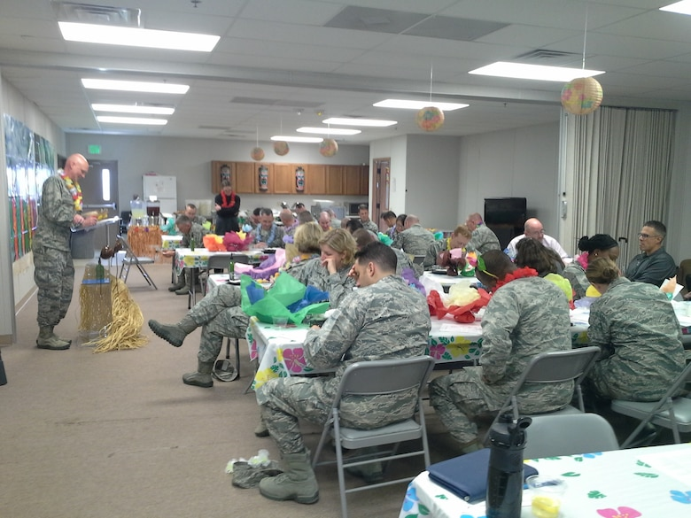 Chaplain (Maj.) Martin Adamson, 50th Space Wing, leads base leadership in a trivia game during a leadership appreciation luncheon at Schriever Air Force Base, Colorado, Tuesday, April 26, 2016. The free luau-themed luncheon was held to honor leaders. It also included games and giveaways. (Courtesy photo)