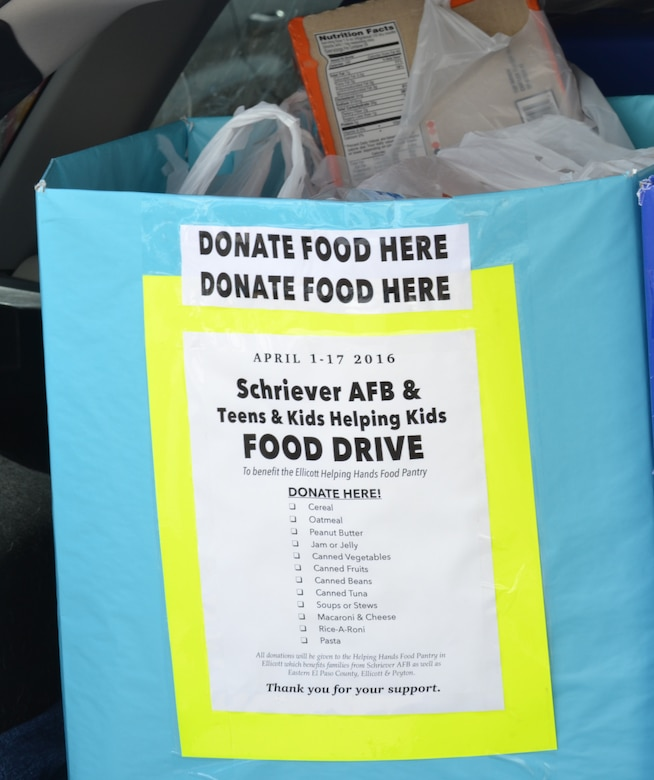 A food collection box sits in the trunk of a vehicle outside the Ellicott Helping Hands Food Pantry in Ellicott, Colorado, Tuesday, April 26, 2016. The box was one of several filled by the Schriever Air Force Base Teens/Kids Helping Kids program during its spring food drive. The flyer on the front of the box was given to patrons of the Peterson Air Force Base commissary during a collection event April 23-24. (U.S. Air Force photo/Brian Hagberg)