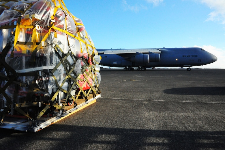 A U.S. Air Force C-5 Galaxy cargo aircraft taxis from the flightline at Keflavik International Airport, April 28, 2016 as equipment sits ready to be loaded. The equipment and approximately 200 Airmen assigned to the 104th Fighter Wing, Barnes Air National Guard Base, Mass., completed the Icelandic Air Surveillance mission and will travel to Estonia to conduct training and partnership operations there. (U.S. Air Force photo by Master Sgt. Kevin Nichols/Released)