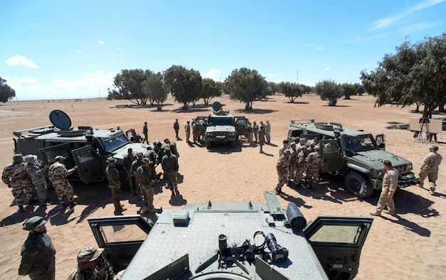 Participants of AFRICAN LION 16 examine Humvees from different countries at Tifnit, Morocco, April 20, 2016. The training began with vehicle familiarization and concluded with an exercise in convoy operations. (U.S. Air Force photo by Senior Airman Krystal Ardrey/Released)