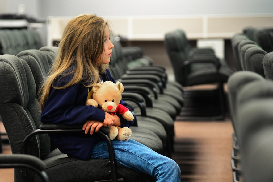 A child waits in the pre-deployment processing room before the kick-off of Operation KUDOS (Kids Understanding Deployment Operations) April 30, 2016, at Cannon Air Force Base, N.M. The day-long event was designed to provide children a first-hand view of what their parents go through in order to prepare for a deployment. (U.S. Air Force photo/Staff Sgt. Alexx Pons)