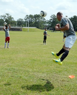 Staff Sgt. Rocky Fredin, goalie and team captain, All-Marine Men's Soccer Team, practices hitting the soccer ball with his head during the All-Marine Men's Soccer Team tryouts aboard Marine Corps Logistics Base Albany, Ga., April 25. Fredin, a native of Lawrenceville, Ga., has been nicknamed the 'grand old man' by his teammates because this is his sixth time being selected for the All-Marine Men's Soccer Team.
