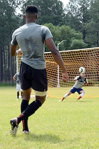 Sgt. Miguel Cebrero, goalie, All-Marine Men's Soccer Team, blocks a shot from Sgt. Jean St. Germain, during the All-Marine Men's Soccer Team tryouts aboard Marine Corps Logistics Base Albany, Ga., April 25. Cebrero is a supply chief with 3rd Low Altitude Air Defense, Camp Pendleton, Calif. Germain is a supply administration clerk with 2nd Radio Battalion, Camp Lejeune, N.C.