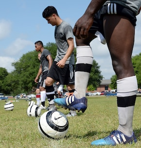 Members of the All-Marine Men's Soccer Team practice aboard Marine Corps Logistics Base Albany, Ga., April 26.