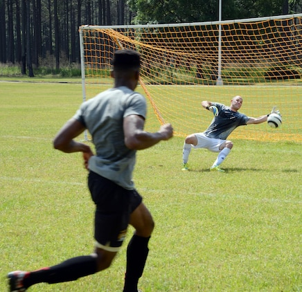 Staff Sgt. Rocky Fredin, goalie and team captain, All-Marine Men's Soccer Team, blocks a shot from Sgt. Jean St. Germain, a team member during the All-Marine Men's Soccer Team tryouts aboard Marine Corps Logistics Base Albany, Ga., April 26. Fredin, a native of Lawrenceville, Ga., has been nicknamed the 'grand old man' by his teammates because this is his sixth time being selected for the All-Marine Men's Soccer Team. Germain is a supply administration clerk with 2nd Radio Battalion, Camp Lejeune, N.C.