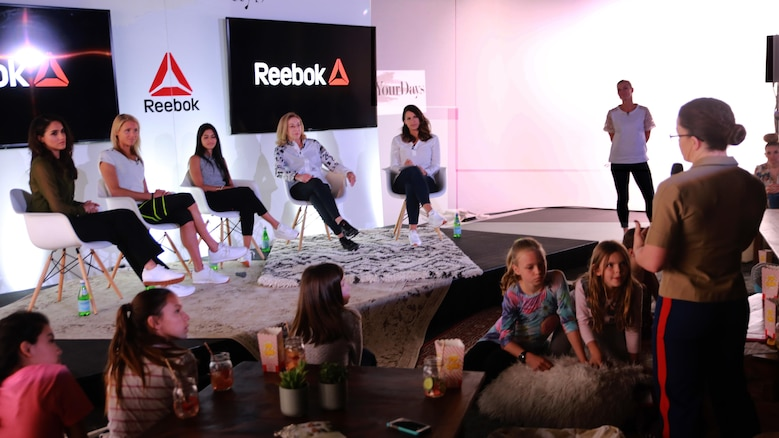 Major Misty Posey speaks to a panel of women at the Reebok Headquarters' Honor Your Days event in Canton, Massachusetts, April 28, 2016. Posey was invited to the event due to her hardwork and dedication to the Corps, and to show young women that they can achieve their dreams. Posey spoke the the panelists and attendees about her dream to help women train to do pull-ups, and told them that anything is possible if they set their heart and mind to it. She hopes to spread the word about her pull-up program to help men and women across the nation.