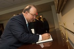 Colombian Defense Minister Luis Carlos Villegas signs a guest book before meeting with Deputy Defense Secretary Bob Work at the Pentagon, May 4, 2016. DoD photo by Air Force Senior Master Sgt. Adrian Cadiz