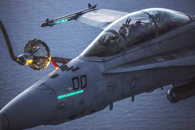 Marines refuel in the air over Iwakuni, Japan, April 28, 2016, practicing during the day and night to prepare for any scenario. The Marines are assigned to Marine Aerial Refueler Transport Squadron 152 and Marine All-Weather Fighter Attack Squadron 242. Marine Corps photo by Cpl. Nathan Wicks