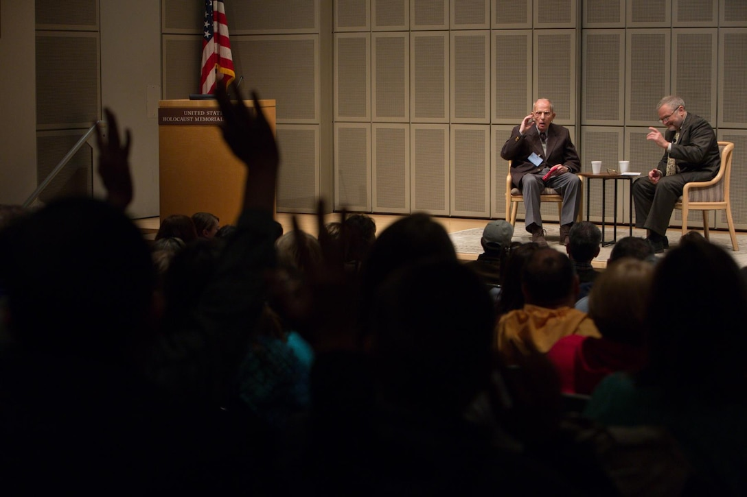 """Bob Behr, left, is interviewed during a """"First Person"""" event at the U.S. Holocaust Memorial Museum in Washington, D.C., in April 2014. Following his liberation in 1945, Behr, a Holocaust survivor, would eventually immigrate to the U.S., where he enlisted in the Army, and later worked for the Air Force as a civilian in the intelligence field for more than 35 years. (Photo courtesy/U.S. Holocaust Memorial Museum)"""