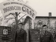 Bob Behr, right, and another American Soldier pose outside of the German-American Youth Club in Germany. Following his liberation in 1945, Behr, a Holocaust survivor, would eventually immigrate to the U.S., where he enlisted in the Army, and later worked for the Air Force as a civilian in the intelligence field for more than 35 years. (Photo courtesy/U.S. Holocaust Memorial Museum)