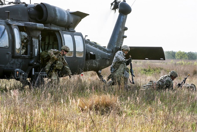 Paratroopers exit a UH-60 Black Hawk helicopter during an air assault mission as part of a training exercise to repair damaged airfields at Fort Bragg, N.C., April 27, 2016. Army photo by Sgt. Juan F. Jimenez