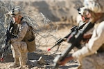 Marines assigned to 1st Marine Logistics Group, Marine Corps Base Camp Pendleton, Calif., provide 360-degree security as part of a quick-reaction force team exercise, Feb. 11, 2015. A Navy SEAL quick-reaction force member was killed May 3, 2016, during an intense battle when Islamic State of Iraq and the Levant fighters attacked peshmerga forces in Iraq. Air Force photo by Tech. Sgt. Efren Lopez