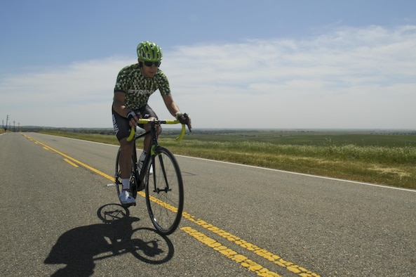 Staff Sgt. Andrew Bergdorf, 9th Civil Engineer Squadron power production supervisor, rides his road bike on Beale Air Force Base, California, April 19, 2016. Bergdorf has been selected to compete in the Department of Defense Wounded Warrior Games which will take place at the U.S. Military Academy in West Point, New York, June 14-22, 2016. (U.S. Air Force photo by Senior Airman Michael J. Hunsaker)