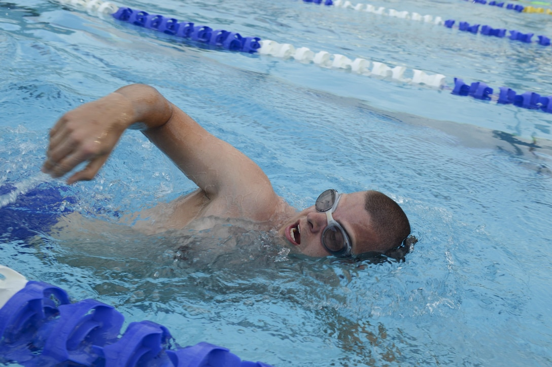 Staff Sgt. Andrew Bergdorf, 9th Civil Engineer Squadron power production supervisor, takes a breath as he swims in the pool at the Gauche Aquatics Park in Yuba City, California, April 21, 2016. Bergdorf has been selected to compete in the Department of Defense Wounded Warrior Games which will take place at the U.S. Military Academy in West Point, New York, June 14-22, 2016. (U.S. Air Force photo by Senior Airman Michael J. Hunsaker)