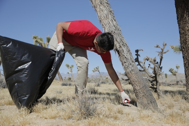 Pfc. Richard Mora Fernandez, student, Marine Corps Communications-Electronics School, helps restore the Gateway Parcel during the Mojave Desert Land Trust Earth Day Restoration in Joshua Tree, Calif., April 23, 2016. (Official Marine Corps photo by Pfc. Dave Flores/Released)