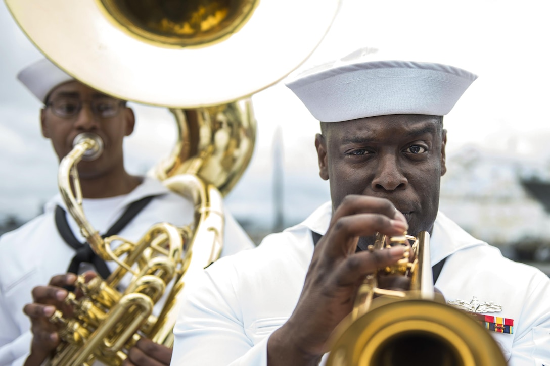 U.S. Fleet Forces Band performs pier side as the USS Arlington returns home to Norfolk, Va., May 3, 2016, after a seven-month deployment. The amphibious transport dock ship arrived at Naval Station Norfolk after conducting maritime security operations and theater security cooperation efforts in the U.S. 5th and 6th Fleet areas of responsibility. Navy photo by Petty Officer 3rd Class Kameren Guy Hodnett