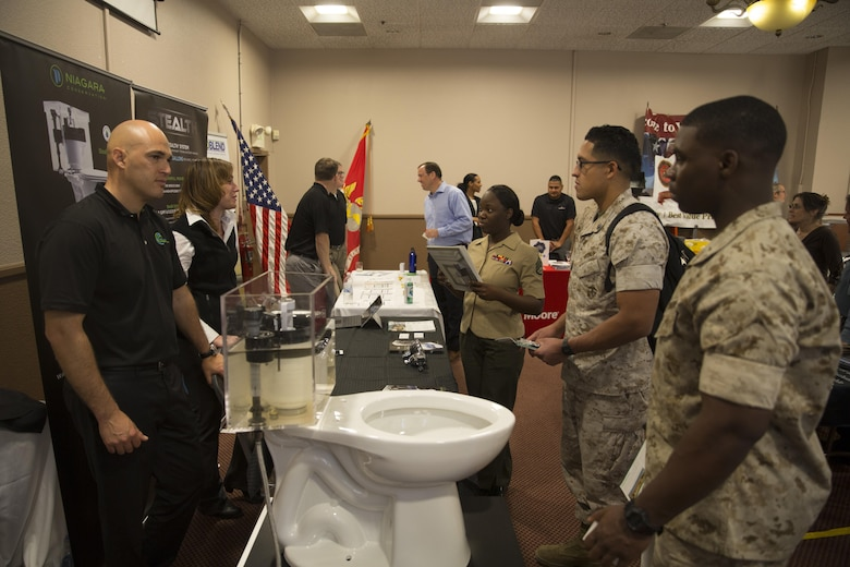 Vendors demonstrate water sustainability products to Marines during the Combat Center's Sustainability Expo at the Frontline Restaurant April 26, 2016. (Official Marine Corps photo by Cpl. Connor Hancock/Released)