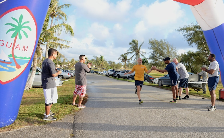 U.S. Navy Chief Petty Officer Jonathan Fischer, Helicopter Sea Combat Squadron 25 won first place during the Asian American Pacific Islander Heritage Month 5K May 4, 2016, at Andersen Air Force Base, Guam. The 5K marked the first event to occur during Asian American Pacific Islander Heritage Month, honoring the contributions of Asian Americans and Pacific islanders nationwide. (U.S. Air Force photo by Airman 1st Class Arielle Vasquez/Released)
