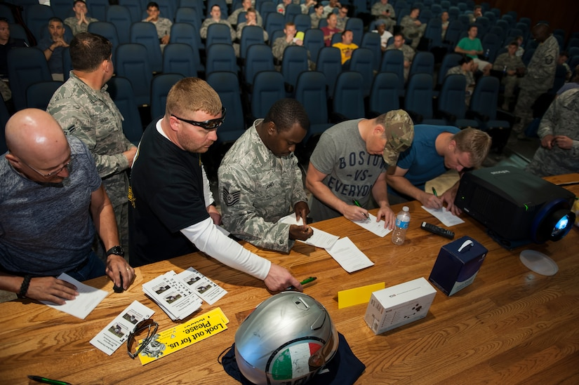 Service members, dependents and civilians sign in during the annual Motorcycle Safety Day, April 29, 2016, at Joint Base Charleston, S.C. The annual briefing is required by AFI 91-207, for all active duty Air Force motorcyclists. (U.S. Air Force photo/Staff Sgt. Jared Trimarchi)