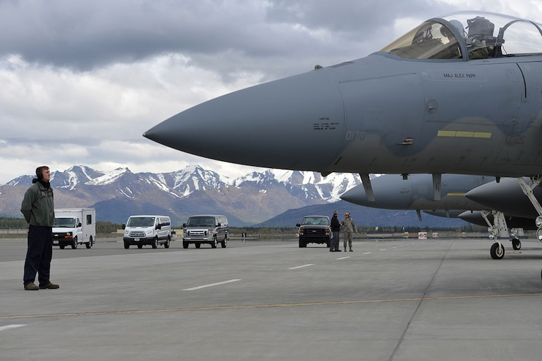 Air Force Staff Sgt. Austin Hamilton, an F-15 crew chief with the 96th Aircraft Maintenance Squadron, Eglin Air Force Base, Fla., stands at parade rest while his pilot prepares to taxi on Joint Base Elmendorf-Richardson's flightline, May 3, 2016. Hamilton is deployed to JBER as part of Red Flag-Alaska, a Pacific Air Forces commander-directed field training exercises for U.S. and international forces, providing combined offensive counter-air, interdiction, close air support and large force employment training in a simulated combat environment. (U.S. Air Force photo by Airman 1st Class Javier Alvarez)