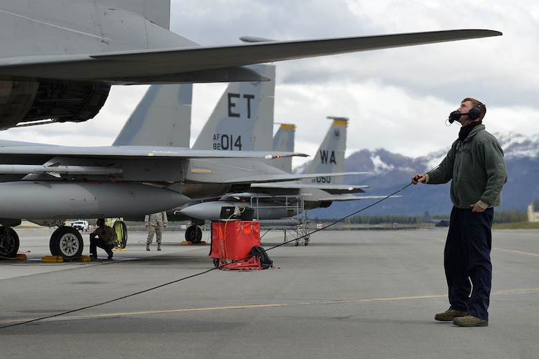 Air Force Staff Sgt. Austin Hamilton, an F-15 crew chief with the 96th Aircraft Maintenance Squadron, Eglin Air Force Base, Fla., performs a preliminary flight check, at the Joint Base Elmendorf-Richardson flightline, May 3, 2016. Hamilton is deployed to JBER as part of Red Flag-Alaska, a Pacific Air Forces commander-directed field training exercises for U.S. and international forces, providing combined offensive counter-air, interdiction, close air support and large force employment training in a simulated combat environment. (U.S. Air Force photo by Airman 1st Class Javier Alvarez)