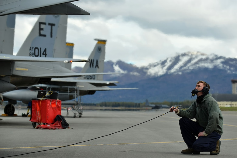 Air Force Staff Sgt. Austin Hamilton, an  F-15 Eagle crew chief with the 96th Aircraft Maintenance Squadron, Eglin Air Force Base, Fla., performs routine checks while his pilot prepares to taxi on Joint Base Elmendorf-Richardson's flightline May 3 during RED FLAG-Alaska 16-1. RF-Alaska is a Pacific Air Forces commander-directed field training exercise for U.S. and international forces, which provides joint offensive counter-air, interdiction, close air support, and large-force employment training in a simulated combat environment. (U.S. Air Force photo by Airman 1st Class Kyle Johnson)