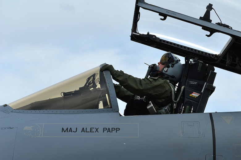 An Air Force F-15 Eagle pilot from Eglin Air Force Base, Fla., stretches as he settles into the cockpit on the Joint Base Elmendorf-Richardson flightline during RED FLAG-Alaska 16-1. RF-Alaska is a Pacific Air Forces commander-directed field training exercise for U.S. and international forces, which provides joint offensive counter-air, interdiction, close air support, and large-force employment training in a simulated combat environment. (U.S. Air Force photo by Airman 1st Class Kyle Johnson)