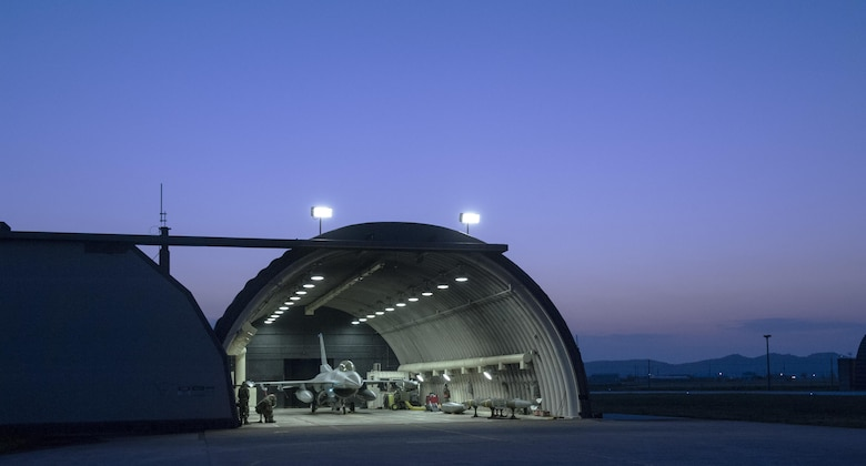 Airmen from the 35th Aircraft Maintenance Unit perform preflight checks on an F-16 Fighting Falcon during Beverly Midnight 16-3 at Kunsan Air Base, Republic of Korea, May 4, 2016. The exercise accentuated the importance of maintaining heightened readiness and aircraft alert levels to ensure security on the Korean peninsula. (U.S. Air Force photo by Staff Sgt. Nick Wilson/Released)