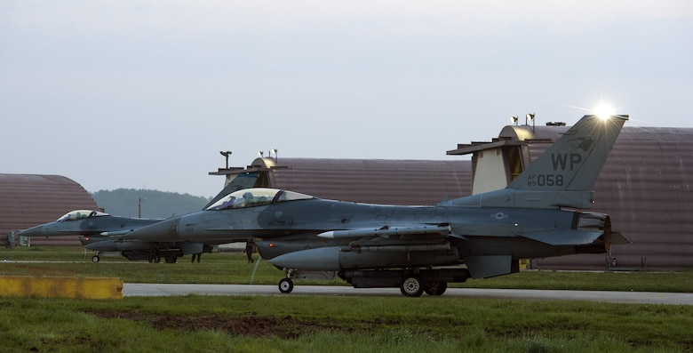 F-16 Fighting Falcons from the 35th Fighter Squadron perform preflight checks during Beverly Midnight 16-3 at Kunsan Air Base, Republic of Korea, May 4, 2016. The exercise accentuated the importance of maintaining heightened readiness and aircraft alert levels to ensure security on the Korean peninsula. (U.S. Air Force photo by Staff Sgt. Nick Wilson/Released)