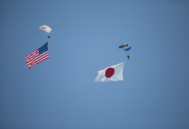 Pemberton Aerosports executed a flag jump during the Marine Corps Air Station Iwakuni Friendship Day 2016 Air Show, Japan, May 5, 2016. Since 1973, MCAS Iwakuni has conducted a single-day air show and open house specifically designed to foster positive relationships between the air station and our Japanese hosts, and the event traditionally draws more than 200,000 visitors and participants. This year is the 40th Friendship Day, offering a culturally enriching experience that displays the mutual support that the U.S. and Japan share. This annual event showcases a variety of static displays, aviation performances and demonstrations, and provides food and entertainment for guests of the largest single-day event in Iwakuni.  (U.S. Marine Corps photo by Cpl. Douglas Simons/Released)