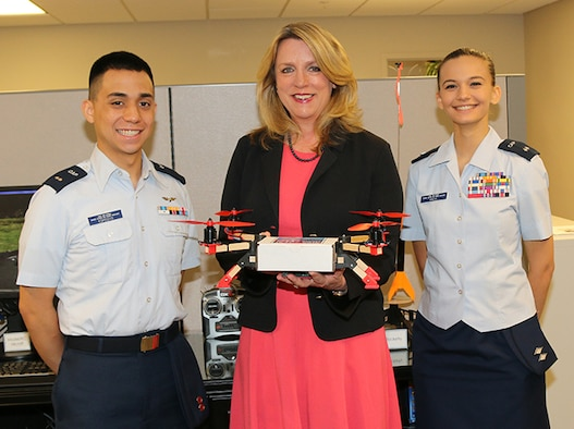 """Civil Air Patrol Cadet 1st Lt. Antonio Esposito (left) of the Tuscaloosa Composite Squadron and CAP Cadet Lt. Col. Ava Michl (right) of the Bessemer Composite Squadron show Secretary of the Air Force Deborah Lee James a """"quadcopter"""" during her visit to National Headquarters Wednesday. The quadcopter is one of seven available CAP STEM (Science, Technology, Engineering and Math) Kits used to promote STEM careers nationwide."""