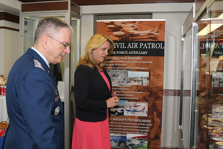 Secretary of the Air Force Deborah Lee James paused at Civil Air Patrol's History Exhibit to share her thoughts on the value and significance of CAP's role as a part of the Air Force Total Force. The display, which is housed in the front lobby at National Headquarters, features artifacts from CAP's 75 years of service.
