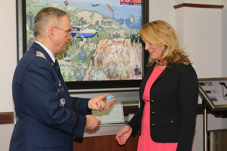 """""""Welcome to your Air Force Auxiliary,"""" said Maj. Gen. Joe Vazquez, Civil Air Patrol's national commander, who presented Secretary of the Air Force Deborah Lee James with the organization's 75th anniversary coin. More information about CAP's anniversary can be found at www.CAP75th.com."""