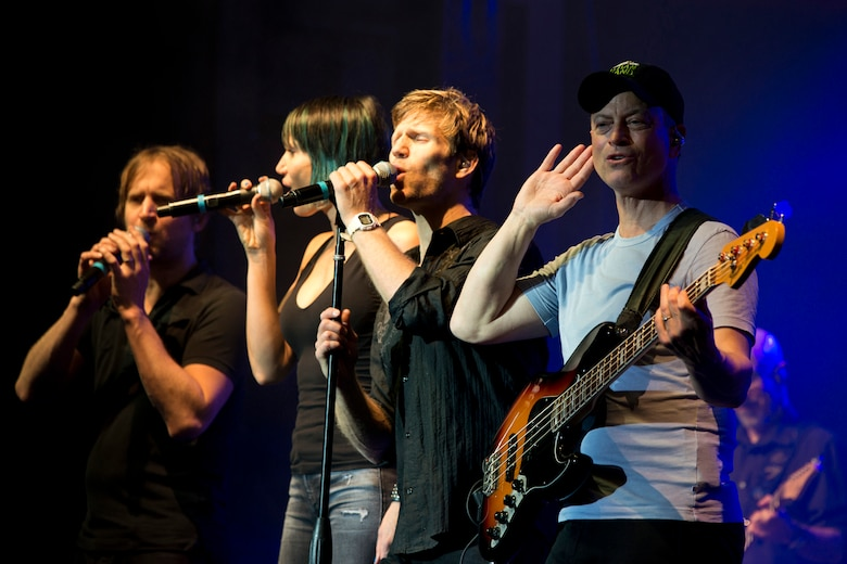 (L-R) Members of The Lt. Dan Band, Dan Myers, Molly Callinan, Jeff Vezain and Gary Sinise perform at Little Rock Air Force Base, Ark., April 29, 2016. The band, which is associated with the Sinise's charity foundation and the United Service Organizations, perform more than 40 concerts for military members and their families each year. (U.S. Air Force photo by Master Sgt. Jeff Walston)