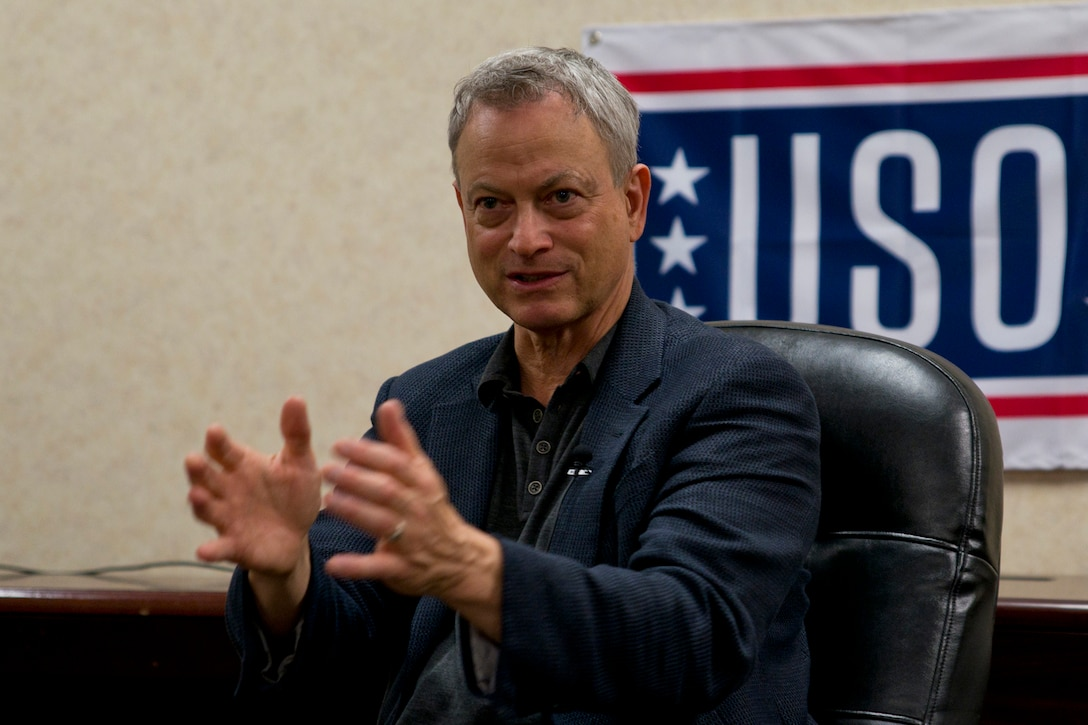 """Gary Sinise explains why he started the Gary Sinise Foundation during a meeting with military and local media at Little Rock Air Force Base, Ark., April 29, 2016. Sinise, an actor and musician, performed a free concert with the Lt. Dan Band at the base, as he has done hundreds of times, for thousands of military audiences around the world. The Lt. Dan Band gets its name from the character Sinise portrayed in the Academy-Award winning movie """"Forrest Gump."""" (U.S. Air Force photo by Master Sgt. Jeff Walston)"""