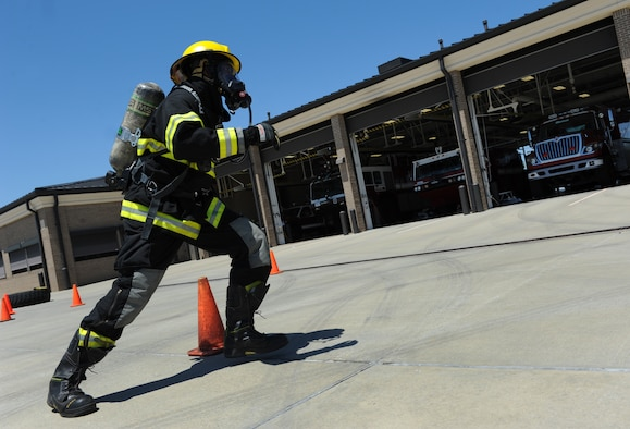 Tech. Sgt. Lawrence Ricks, 81st Infrastructure Division firefighter, runs through the serpentine course at the Keesler Fire Department as he trains for the 2016 Firefighter Combat Challenge Competition Wild Card Week, May 4, 2016, Keesler Air Force Base, Miss. Four members from the fire department competed in the qualifying round at Lake Charles, La., Apr. 30. (U.S. Air Force photo by Kemberly Groue)
