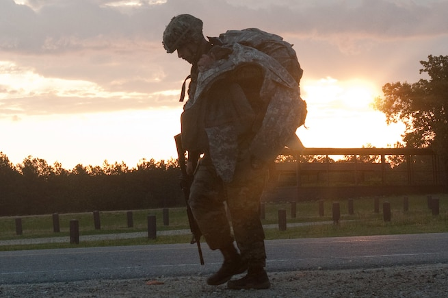 A competitor heads toward the next event after finishing a 10-kilometer foot march at the 2016 U.S. Army Reserve Best Warrior Competition at Fort Bragg, N.C., May 4, 2016. This year's Best Warrior Competition determines the top noncommissioned officer and junior enlisted Soldier who will represent the U.S. Army Reserve in the Department of the Army Best Warrior Competition later this year. (U.S. Army photo by Spc. Tynisha L. Daniel)