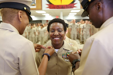 Richmond, Va.-native Mercedes N. Hargrove pins on the rank of Master Chief Petty Officer during a promotion ceremony at Naval Support Facility Indian Head, Md., May 4, 2016. Hargrove serves as the Navy Senior Enlisted Leader with Chemical Biological Incident Response Force. (Official USMC Photo by Sgt. Jonathan Herrera/Released)