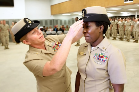 Master Chief Petty Officer Tammy Heap, command master chief for U.S. Marine Corps Forces Command, fits a cover with the rank of Master Chief Petty Officer on Richmond, Va.-native Mercedes N. Hargrove during a promotion ceremony at Naval Support Facility Indian Head, Md., May  4, 2016. Hargrove serves as the Navy Senior Enlisted Leader with Chemical Biological Incident Response Force. (Official USMC Photo by Sgt. Jonathan Herrera/Released)