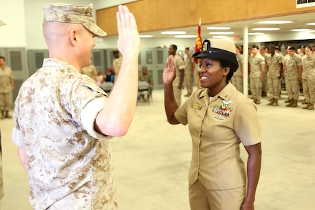 Richmond, Va.-native Mercedes N. Hargrove (right) recites the Oath of Enlistment led by Marine Col. Stephen E. Redifer, commanding officer of Chemical Biological Incident Response Force (CBIRF), during a promotion ceremony at Naval Support Facility Indian Head, Md., May 4, 2016. Hargrove serves as the Navy Senior Enlisted Leader with CBIRF. (Official USMC Photo by Sgt. Jonathan Herrera/Released)