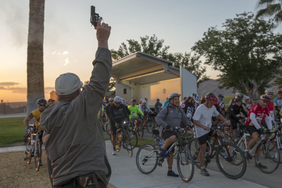 Cyclists await the start of the Park-to-Park Bike Ride at Knott's Sky Park in Twentynine Palms, Calif., April 30, 2016. The event was hosted as a joint effort between the Combat Center, the City of Twentynine Palms and the Joshua Tree National Park Service to celebrate Earth Day as well as the 100-year anniversary of the park. (Official Marine Corps photo by Lance Cpl. Levi Schultz/Released)