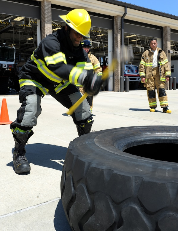 Tech. Sgt. Lawrence Ricks, 81st Infrastructure Division firefighter, hits a tire with a hammer at the Keesler Fire Department as he trains for the 2016 Firefighter Combat Challenge Competition Wild Card Week, May 4, 2016, Keesler Air Force Base, Miss. Four members from the fire department competed in the qualifying round at Lake Charles, La., Apr. 30. (U.S. Air Force photo by Kemberly Groue)
