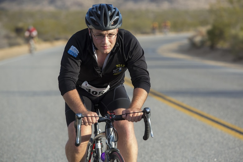 A cyclist completes a 50-mile ride during the Park-to-Park Bike Ride through Joshua Tree National Park, Calif., April 30, 2016. The event was hosted as a joint effort between the Combat Center, the City of Twentynine Palms and the Joshua Tree National Park Service to celebrate Earth Day as well as the 100-year anniversary of the park. (Official Marine Corps photo by Lance Cpl. Levi Schultz/Released)