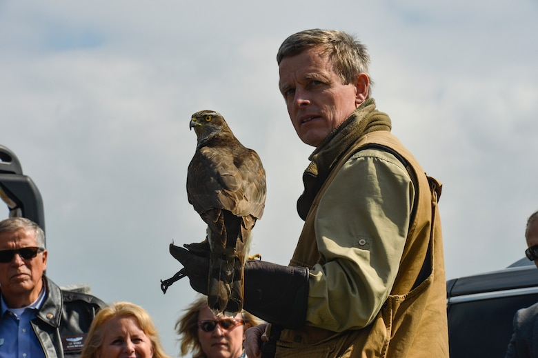 Jens Fleer, a falconer, shows his gyrfalcon used for flightline bird abatement on Spangdahlem Air Base, Germany, to a group of Air Force civic leaders April 19, 2016, during a weeklong civic leader trip to several bases in Europe. Air Force civic leaders are unpaid advisers, key communicators and advocates for the Air Force. (U.S. Air Force photo/Tech. Sgt. Joshua DeMotts)