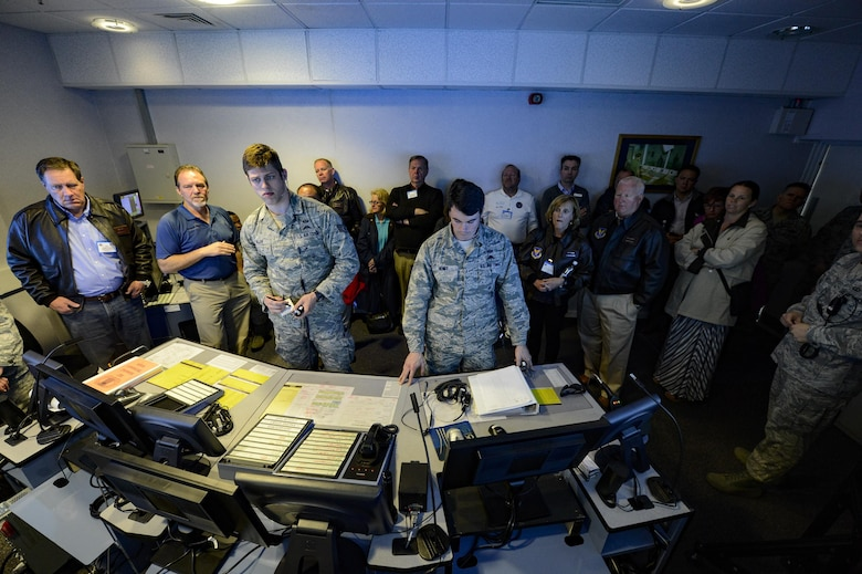 A group of Air Force civic leaders watch a virtual control tower trainer demonstration at Royal Air Force Mildenhall England, April 19, 2016, during a weeklong civic leader trip to several bases in Europe. Air Force civic leaders are unpaid advisers, key communicators and advocates for the Air Force, April 19, 2016. (U.S. Air Force photo/Tech. Sgt. Joshua DeMotts)