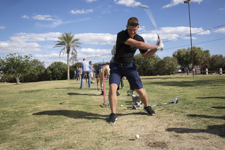 James Middleton, 7, attempts to hit a target with a ball to dunk his father, Lt. Col. Brian Middleton, battalion commander, 3rd Battalion, 4th Marines, 7th Marine Regiment, during the battalion's Family Day at Desert Winds Golf Course April 29, 2016. (Official Marine Corps photo by Lance Cpl. Levi Schultz/Released)