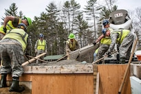 Airmen and Marine Reservists build a porch for a new dining facility at Camp Hinds, Raymond, Maine, May 3, 2016. Air National Guard photo by Airman Tiffany Clark