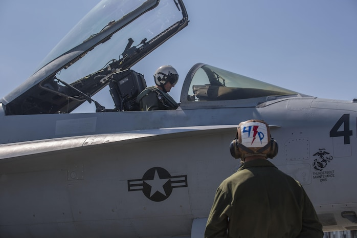 A pilot prepares an F/A-18C Hornet to take off from the flightline aboard Marine Corps Air Station Beaufort May 4. Marine Fighter Attack Squadron 251 is participating in a Weapons Systems Evaluation Program at Tyndall Air Force Base, Fla., May 6-20. The program gives pilots experience with flying against real aircraft outside a simulation. The real world training helps Marines be tactically proficient and prepared to deploy. The pilot is with VMFA-251.